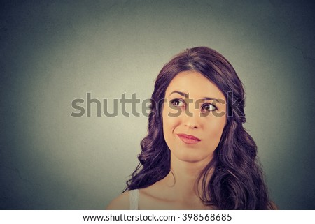 Closeup funny confused skeptical woman thinking planning looking up isolated on gray wall background copy space above head. Human face expression emotion feeling body language, perception reaction - stock photo