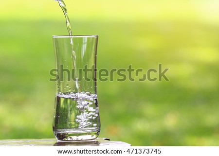 Closeup Glass of water on table nature background.