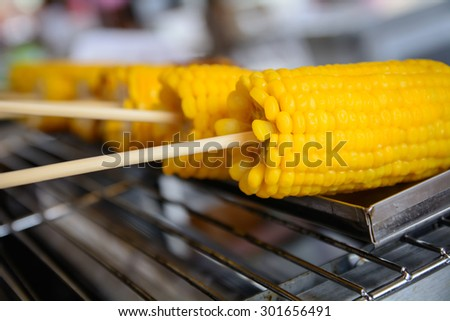 Closeup grilled corn vegetable food background - stock photo