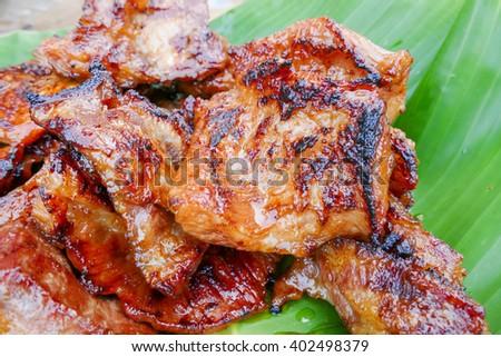 Closeup grilled pork on banana leaf - stock photo