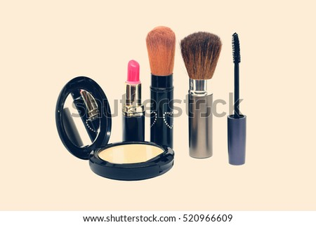 Closeup group of makeup cosmetics vintage tone color.
