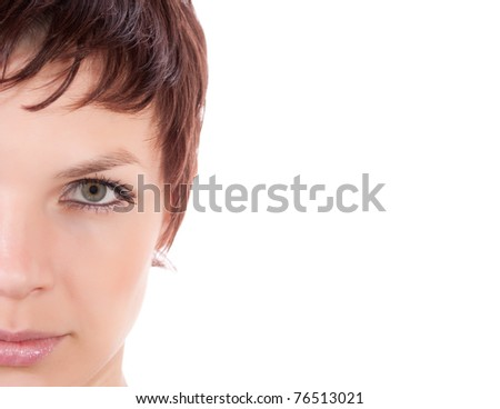 Closeup half face portrait  of charming woman on white background.