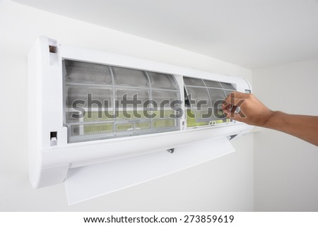 closeup hand during cleaning air conditioner filter  - stock photo