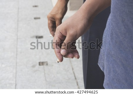 closeup hand Holding Cigarette While Smoking