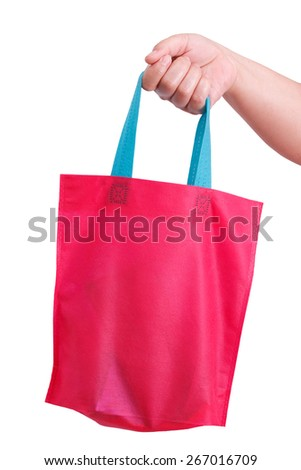 closeup hand holding reusable bag isolate on white clipping path