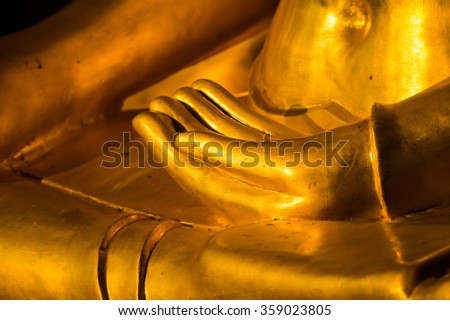 Closeup hand of gold Buddha statue