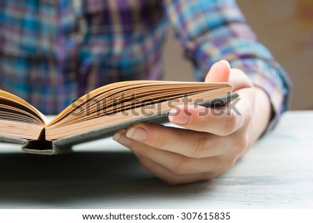 Closeup hand open book for reading concept background - stock photo