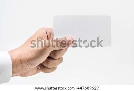 Closeup hand wearing white shirt showing blank paper card isolated on white background. - stock photo