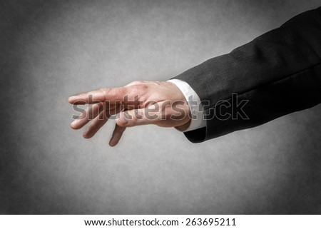 Closeup hand with gesture and arm of a businessman in dark suit