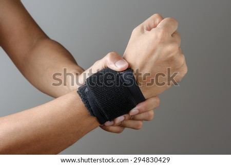 closeup hand with wrist support  - stock photo