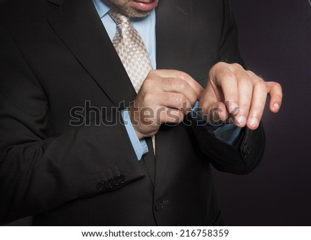 Closeup hands  of a man in suit and tie - stock photo