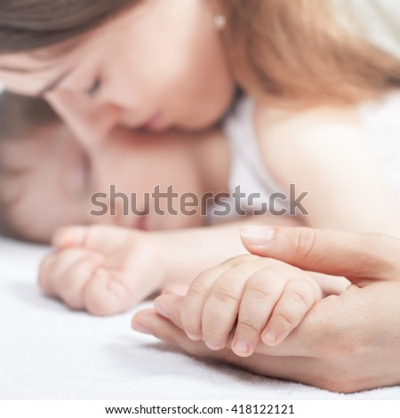 Closeup hands of mother and baby. Care concept. Protection. Healthy sleep. Healthcare. Medical. Mother's care is most important in baby live. White background