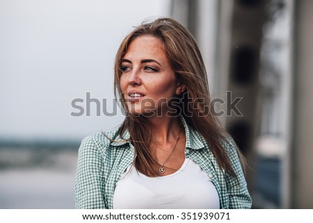 closeup head and shoulders portrait of yong adult smiling beautiful woman - stock photo