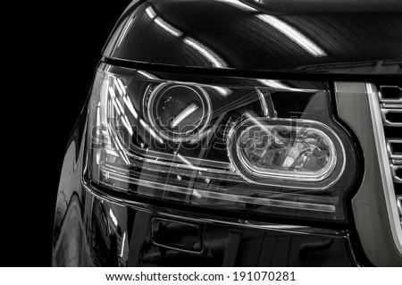 Closeup headlights of modern car.  - stock photo