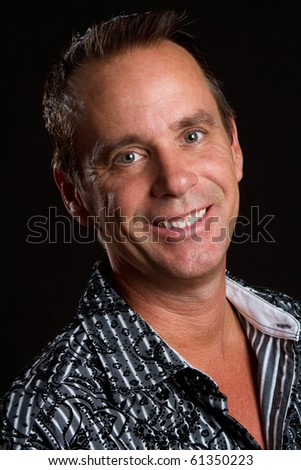 Closeup headshot of smiling man - stock photo