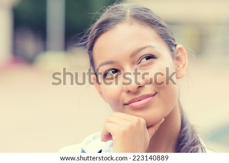 Closeup headshot portrait charming smiling joyful happy business woman looking upwards daydreaming nice future thinking isolated outside background. Positive emotion facial expression feelings  - stock photo