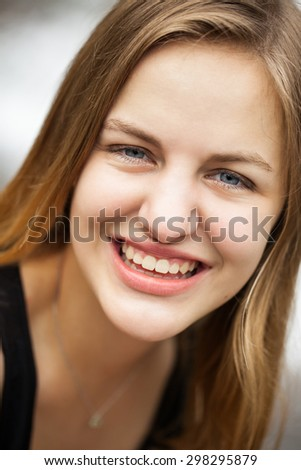 Closeup headshot portrait of a beautiful high school senior teenage girl - stock photo