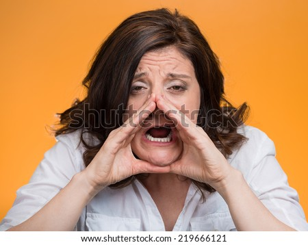 closeup headshot portrait of young angry woman screaming isolated on orange background. Negative face expressions, emotions, feelings - stock photo