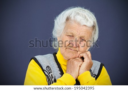 Closeup headshot, portrait sad alone, gloomy, thoughtful, senior, mature woman, grandmother head on hand, thinking, daydreaming isolated blue background. Negative human emotions, facial expressions - stock photo