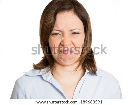 Closeup, headshot unhappy woman wrinkling nose and face, looks displeased, something stinks, bad smell, situation, isolated white background. Human facial expressions, emotions - stock photo
