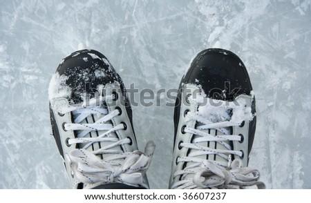 Closeup hockey ice skates in action outdoors. - stock photo
