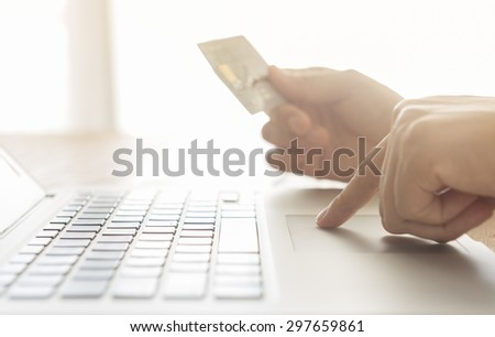 closeup human hands are the order on the Internet with credit cards - stock photo