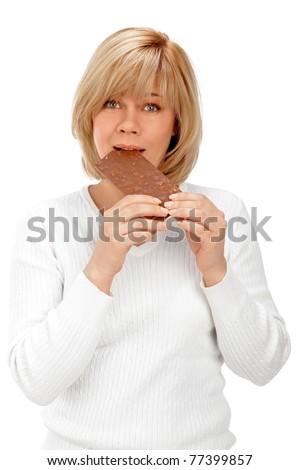 Closeup humorous portrait of a beautiful adult woman holding big chocolate bar - stock photo