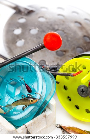 closeup ice fishing tackles with jig, line, rod on white background