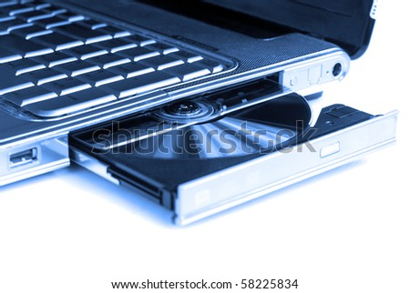 Closeup image from a laptop and a CD Rom / DVD Rom reader - stock photo