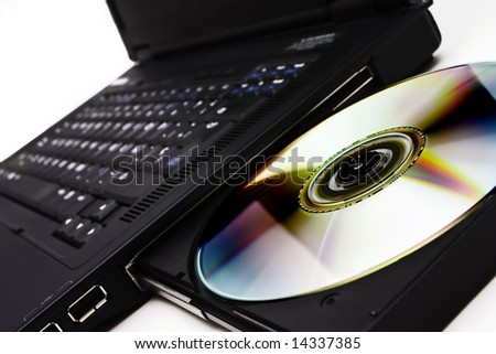 Closeup image from a laptop and a CDRom / DVDRom reader - stock photo