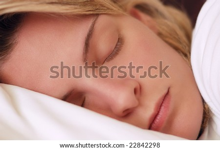 Closeup image of a beautiful young woman sleeping peacefully - stock photo