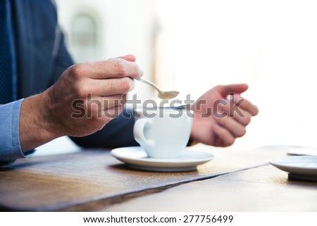 Closeup image of a businessman`s hands with coffee - stock photo
