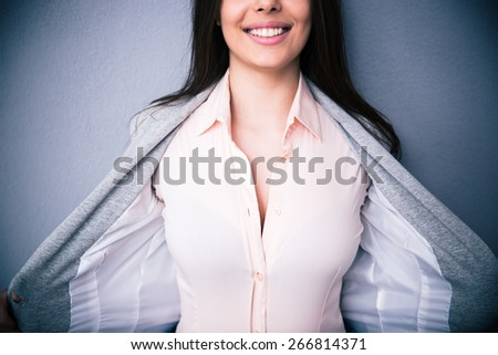 Closeup image of a Businesswoman showing her breasts - stock photo