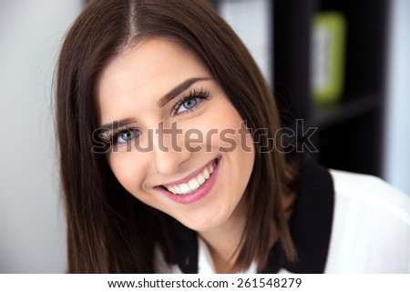 Closeup image of a cheerful young woman - stock photo