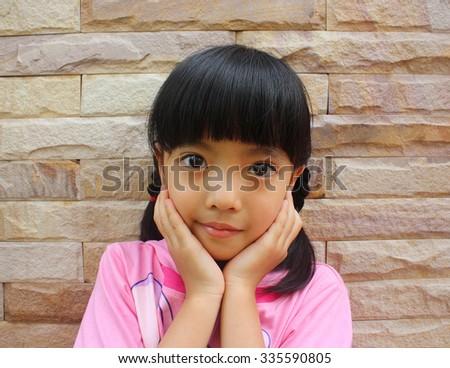 Closeup image of a cute little girl  - stock photo