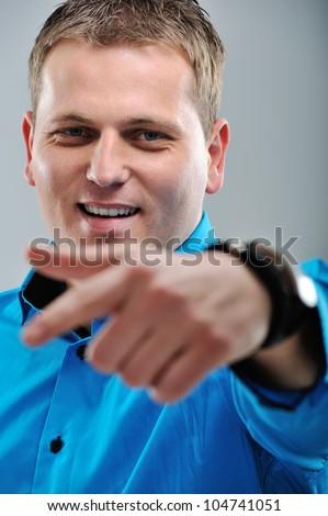 Closeup image of a man pointing forward - stock photo