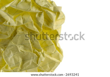 Closeup image of a piece of crumpled writing paper. - stock photo
