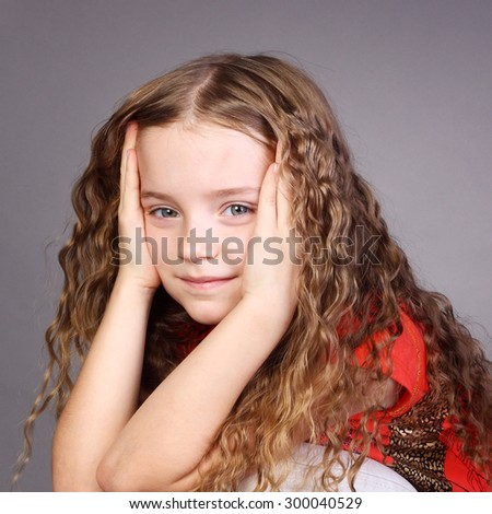 closeup image of a pretty curly little girl