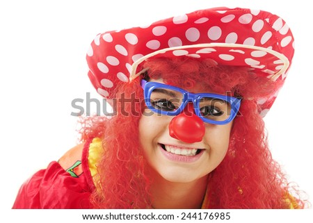 Closeup image of a teenage clown.  On a white background. - stock photo