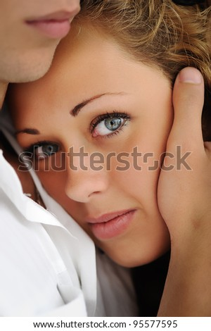Closeup image of a teenage girl and boy holding her head - stock photo