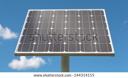 Closeup image of an electrical solar panel with blue sky as a background.