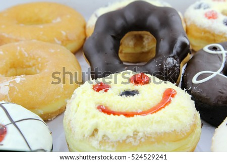 Closeup image of assorted sweet donuts.