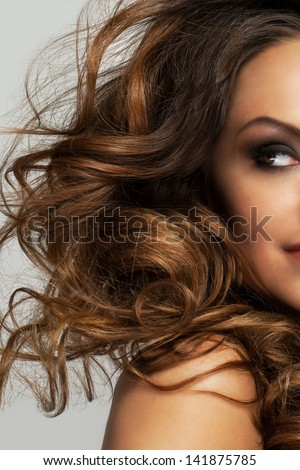 Closeup image of beautiful caucasian woman with curls and evening makeup - stock photo