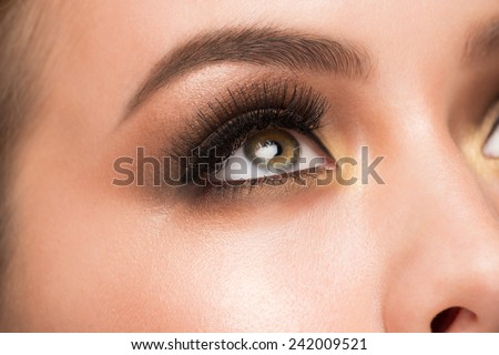Closeup image of beautiful woman eye with fashion bright makeup - stock photo