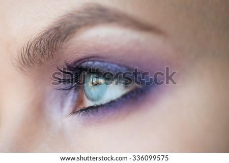 Closeup image of beautiful woman eye with fashion purple makeup  - stock photo