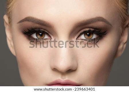 Closeup image of beautiful woman eyes with fancy bright makeup.  - stock photo
