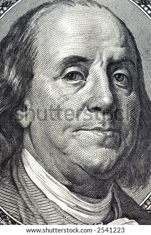 Closeup image of Ben Franklin on the one hundred dollar bill.