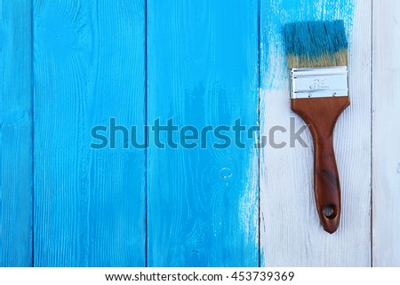 Closeup image of bumpy wooden tabletop painted blue - stock photo