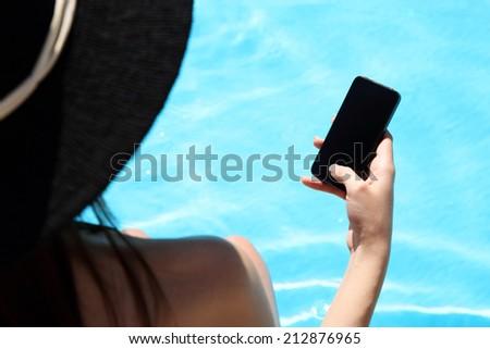 Closeup image of female hand using smartphone - stock photo