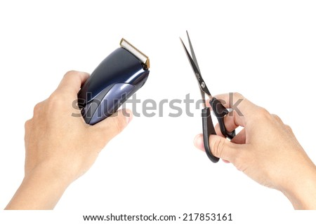 Closeup image of hands holding hair clipper and scissor, isolated on white background - stock photo